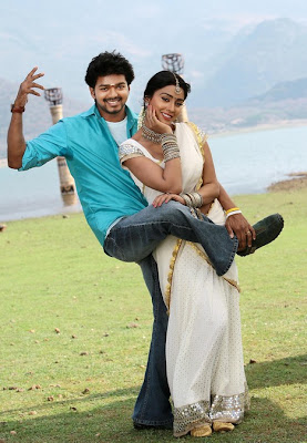 Shriya Saran in white designer saree posing with co-star Vijay
