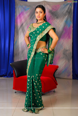 South actress Charmi in green embroidery saree
