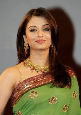 Aishwarya Rai looks stunning in green designer saree and blouse.
