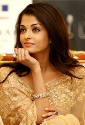Aishwarya Rai in cream designer saree and blouse.