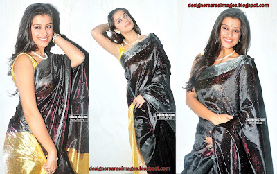 Madhurima in Black Silky Saree with Sleeveless Sari Blouse images