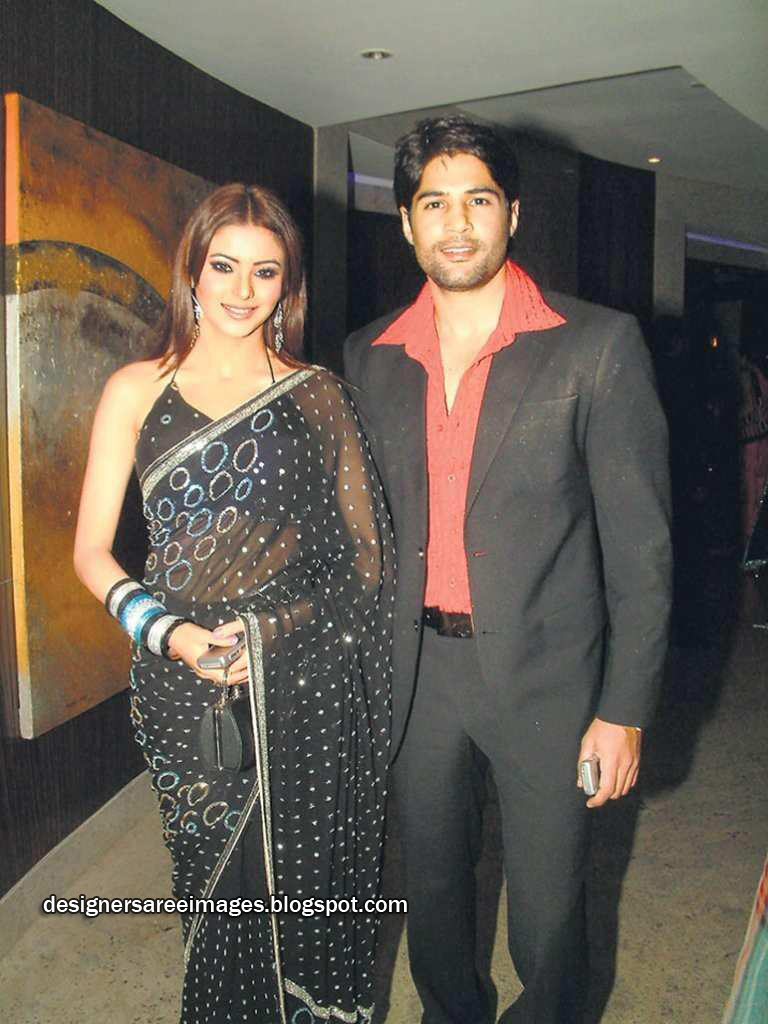 Aamna Sharif in Black Transparent Saree