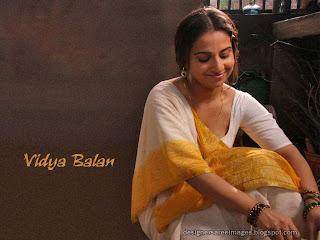 Actress Vidya Balan in white saree with yellow border