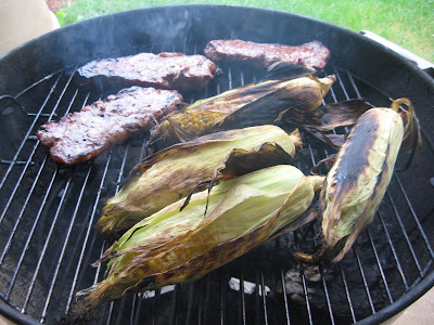 Barbecue master grilled new york strip steak and corn in the grilled new york strip steak and corn in the husks on a weber ccuart Gallery