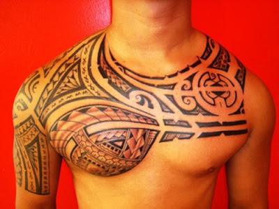 arm chest tattoo.chest and arm tattoos