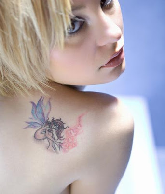 dark fairy tattoos. woman fairy tattoo