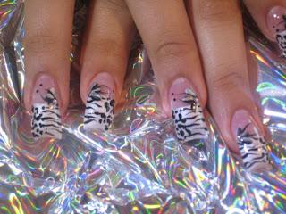 http://4.bp.blogspot.com/_uRqSKXpD1M8/TQ7G0AX0QLI/AAAAAAAAAIw/a9bY5YwllGc/s1600/wild+nail+design.jpg