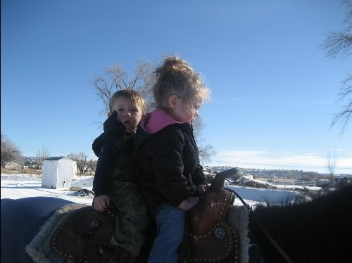 Jersy riding Pepper with cousin Ty