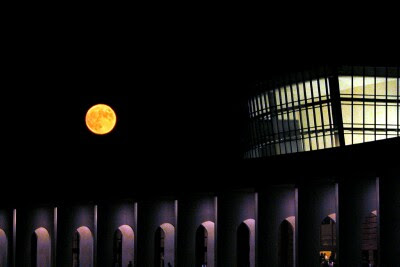 Full moon over Ferguson Center at Christopher Newport University