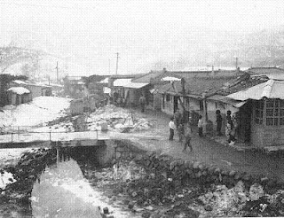Photo of a street in Ouijongbu, 1960 by Bruce Richards