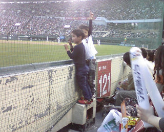 small boys watching game