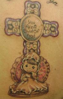 Cute Cherub and Cross tattoo