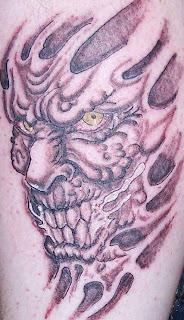 Evil Demon Skin Rip Tattoo