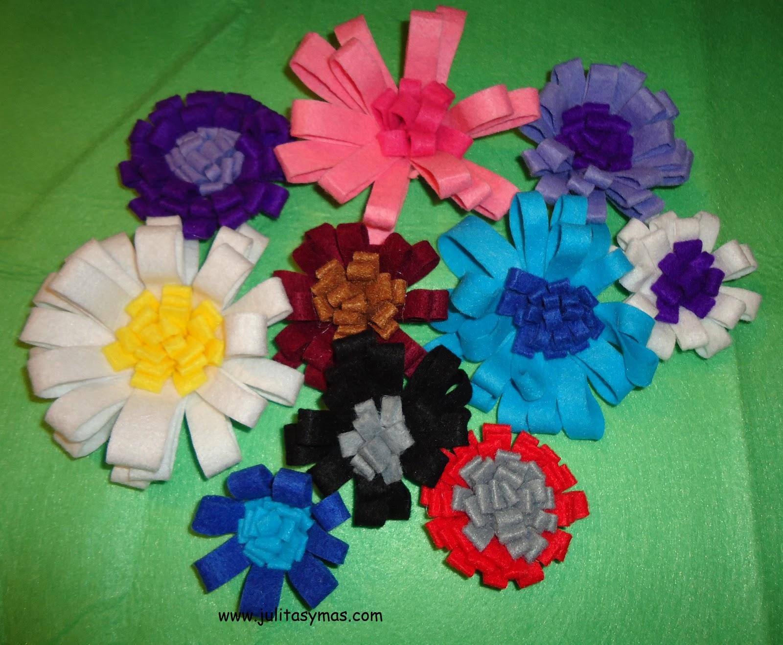 http://4.bp.blogspot.com/_uetC8ZHrlrI/TUsHgDhlzbI/AAAAAAAABik/M61E2JfBXgk/s1600/flores+de+fieltro+.JPG