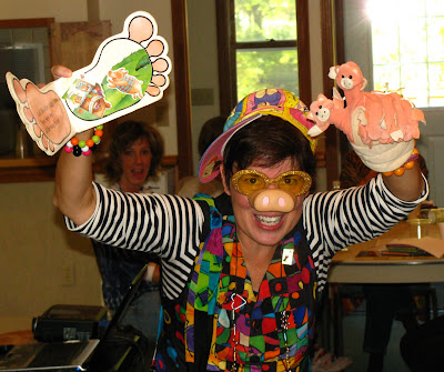 "photo of: Debbie Clement performs her ""Piggy Rap"" (complete with pig nose!)"