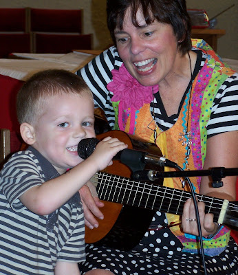 photo of: Debbie Clement sings with her WonderBoy (grandson)
