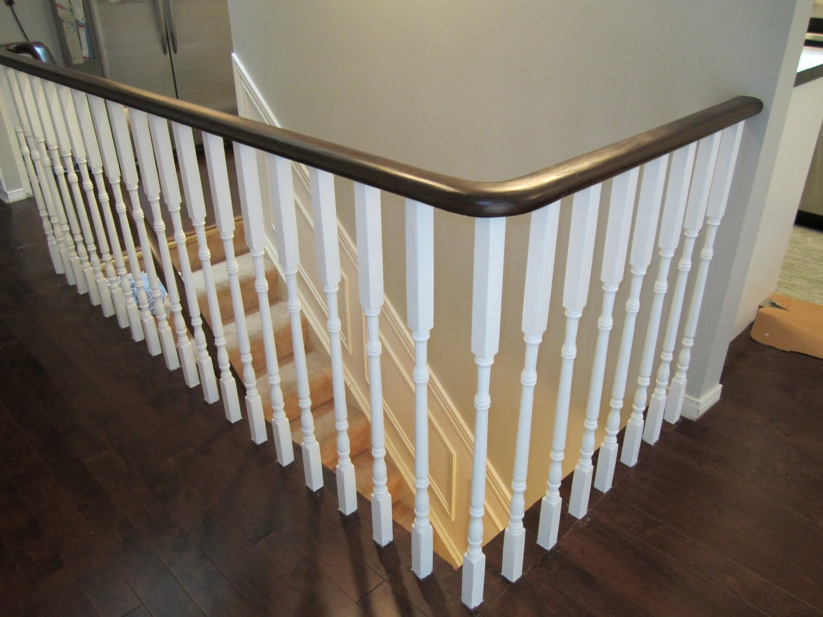 Remodelaholic updating an oak stair or handrail to white - Painting wooden stairs white ...