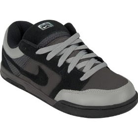 competitive price 946d2 1dc30 Nike Mogan mid top shoes. Padded insole. Padded tongue and collar. Nike  embroidery at back of collar. Elastic tongue restrainer straps. Nike 6.0  label on ...