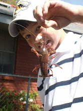 Christian with a live crawfish.