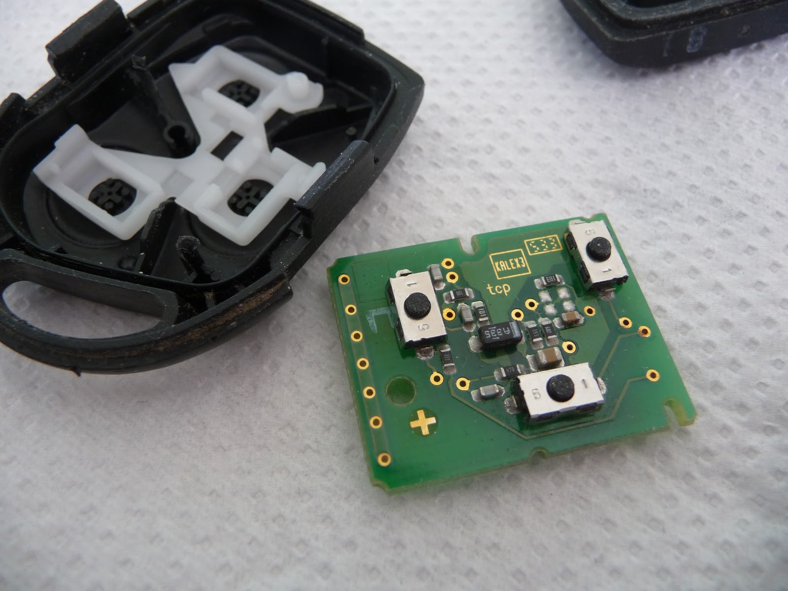 Gently pop the top peg out of the slot in the pcb to release it