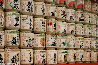 Casks of Japanese sake, devoted to gods in shrine, at Meiji-jingu, in Tokyo