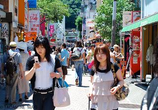 An emailing girl, in Harajuku, Tokyo