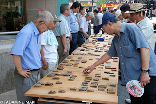 Mens enjoying Shogi on the street, Tokyo