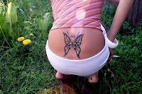 borboleta+coccix+femina+sensual+tatuagem