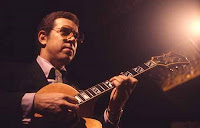 photo of Kenny Burrell playing guitar
