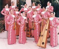 Photo of Mariachi Reyna de Los Angeles dressed in pink mariachi costumes and holding instruments