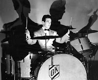 Famous photo of Gene Krupa at his drumset with a large shadow cast on the wall behind him