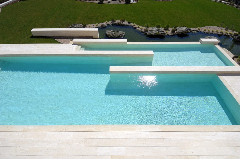 houses in spain with pools. House with big windows and the