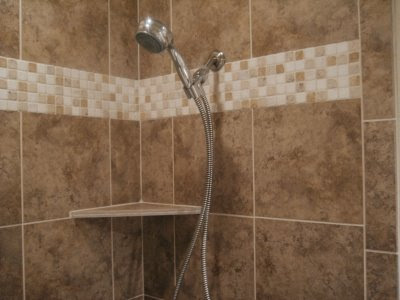 tile around tub shower combo. We just completed this simple but elegant tub shower combo  The owner selected a dark brown tile with tumbled marble band around the top Simple and Elegant TIle Confessions Of A Tile Setter