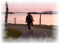 bicycle rider at dawn with a faded edge photo frame or border