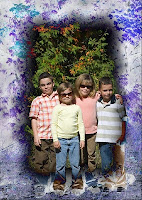 photo of 4 children in a forested setting using a photo frame