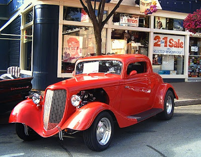 free photo of a bright red vintage coupe done up in as a hot-rod