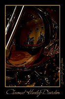 painting with light photograph - a chrome and brass plated harley davidsom motorcycle tank