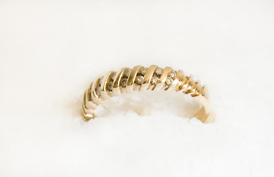gold eternity band with small diamonds