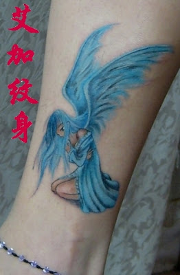 An angel tattoo with blue clothes and blue wings.