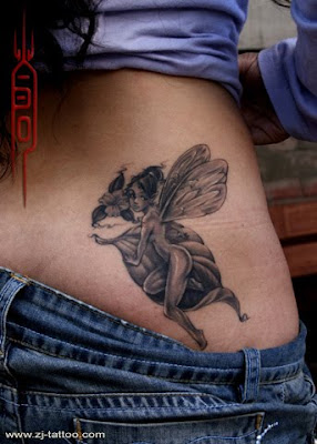 a fairy tattoo design on the lower back