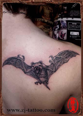 a bat tattoo design on the back