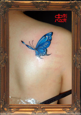 blue butterfly tattoo on the back