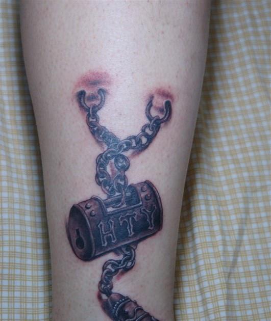 free tattoo designs lock tattoo on the leg. Black Bedroom Furniture Sets. Home Design Ideas