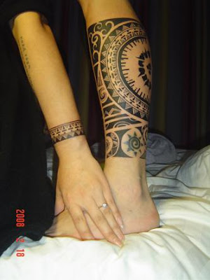 Matching tribal tattoo for arm and leg