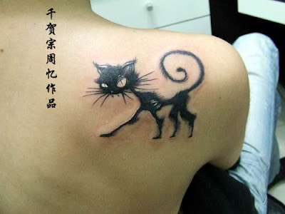 A skinny and angry cat tattoo below the shoulder