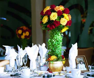 Tall Rose Centerpiece with Orange Red and Yellow Roses from Flowers by Erin