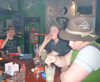 Boys smoking through straws in a bar in Zell am See, Austria