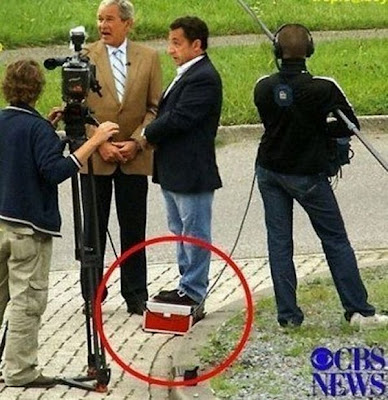 Nicolas Sarkozy standing on a box