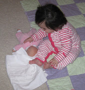 putting her baby to sleep before bed time