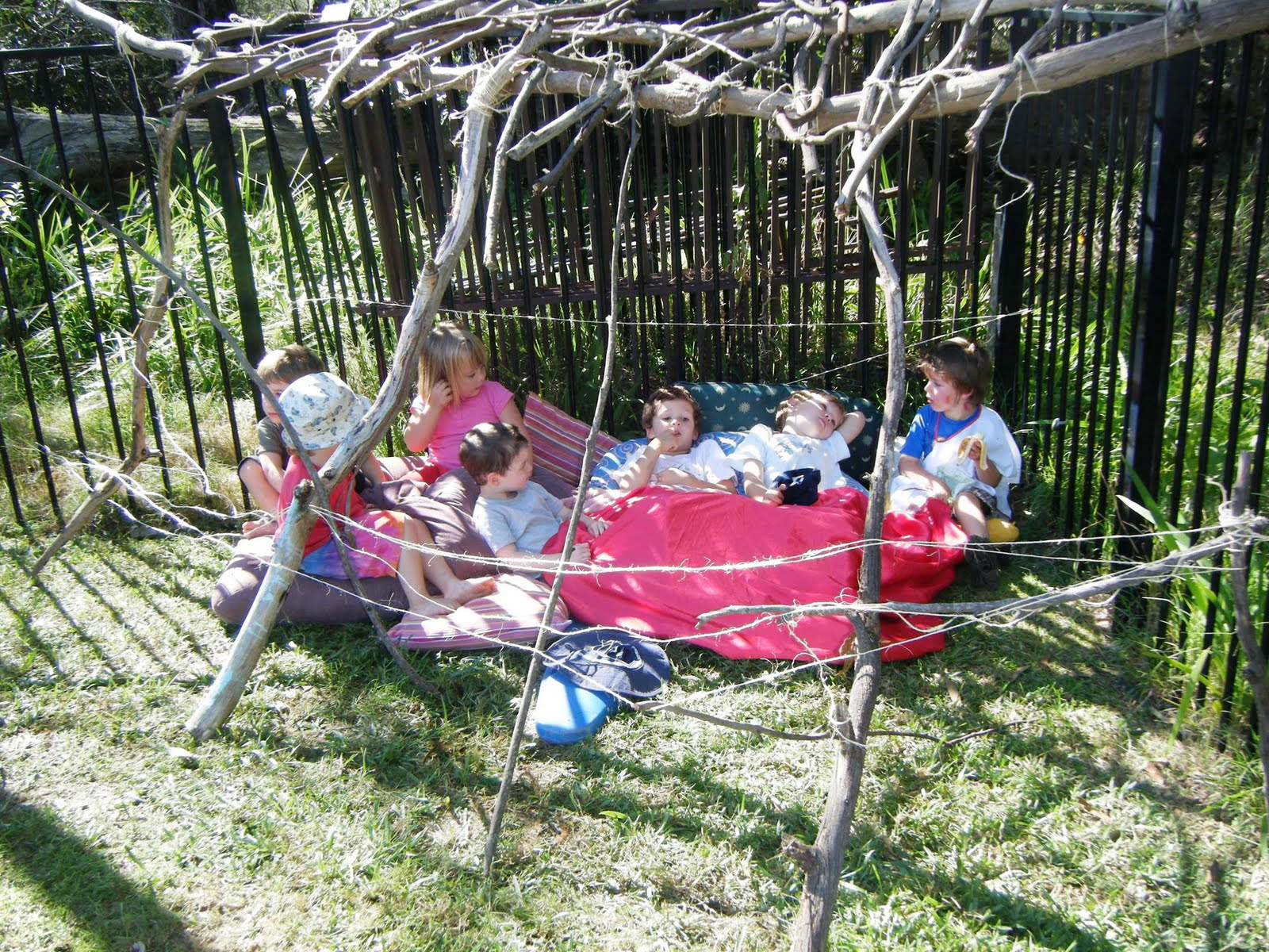 let the children play building a bush shelter at preschool